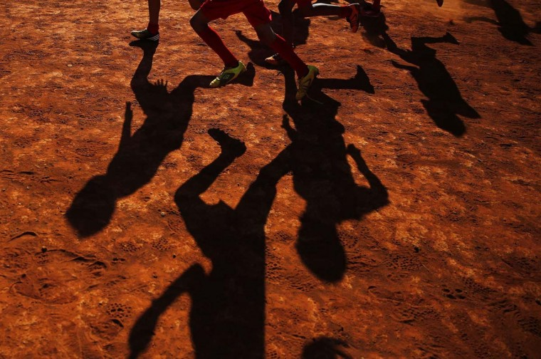 "Young players of Planaltina football club practise in Planaltina July 3, 2014. In a project called ""On The Sidelines"", Reuters photographers share pictures showing their own quirky and creative view of the 2014 World Cup in Brazil. Picture taken July 3. (Damir Sagolj /Reuters)"