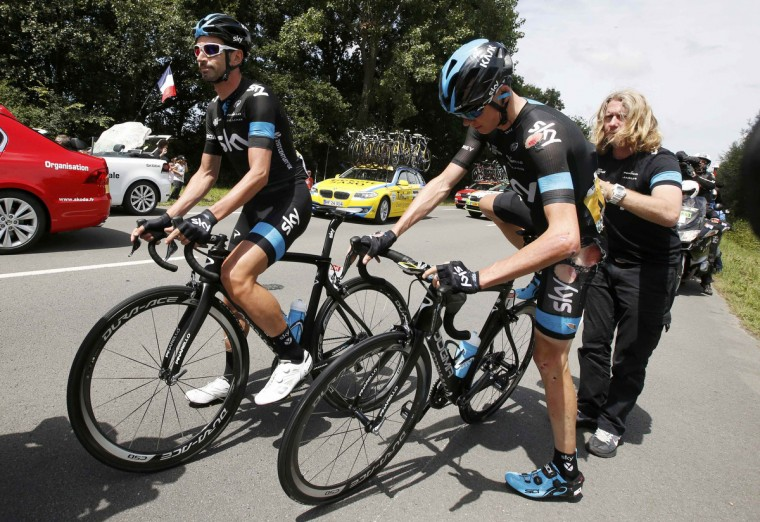 Team Sky rider Christopher Froome of Britain gets assistance after crashing during the 163.5 km fourth stage of the Tour de France cycling race from Le Touquet-Paris-Plage to Lille July 8, 2014. (Jacky Naegelen/Reuters)