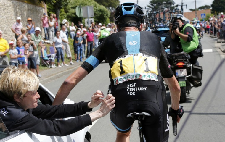 Team Sky rider Christopher Froome of Britain gets medical assistance after crashing during the 163.5 km fourth stage of the Tour de France cycling race from Le Touquet-Paris-Plage to Lille July 8, 2014. (Jean-Paul Pelissier/Reuters)