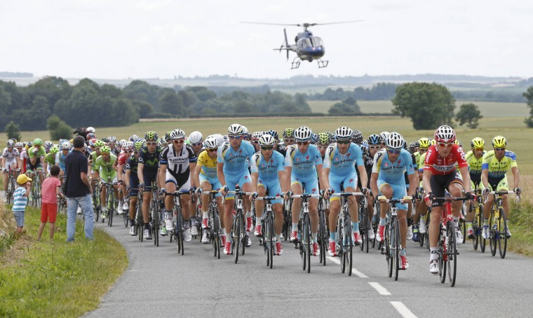 The pack of riders cycles on its way during the 163.5 km fourth stage of the Tour de France cycling race from Le Touquet-Paris-Plage to Lille July 8, 2014. (Jean-Paul Pelissier/Reuters)