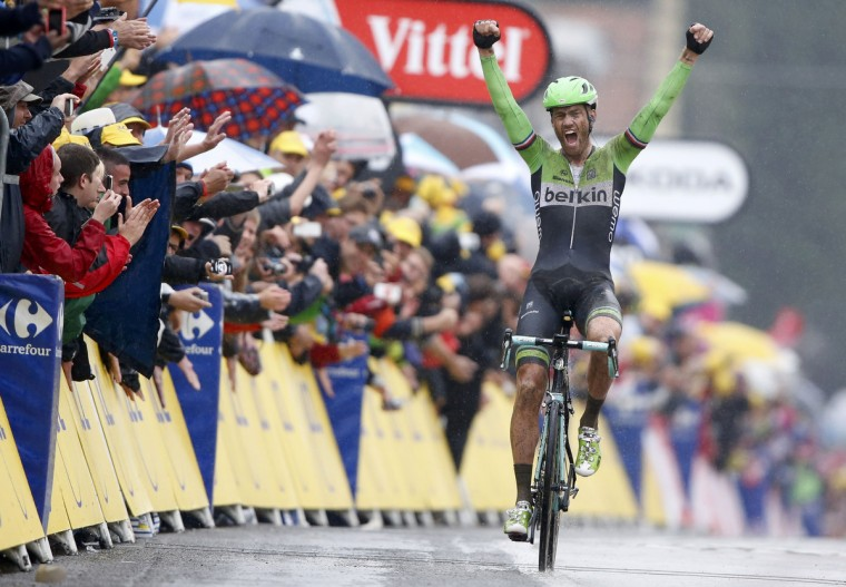 Belkin team rider Lars Boom of the Netherlands celebrates as he wins the 155.5 km fifth stage of the Tour de France cycling race from Ypres Belgium to Arenberg Porte du Hainaut July 9, 2014. (Jacky Naegelen/Reuters)