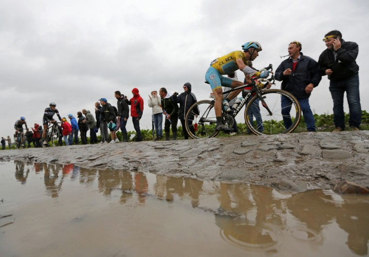 Astana team rider Vincenzo Nibali of Italy cycles on a cobble-stoned section during the 155.5 km fifth stage of the Tour de France cycling race from Ypres Belgium to Arenberg Porte du Hainaut July 9, 2014. (Jean-Paul Pelissier/Reuters)