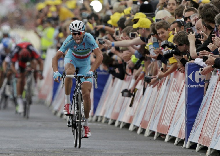 Astana team rider Vincenzo Nibali of Italy celebrates as he crosses the finish line to win the second 201 km stage of the Tour de France cycling race from York to Sheffield, July 6, 2014. (Jacky Naegelen/Reuters)