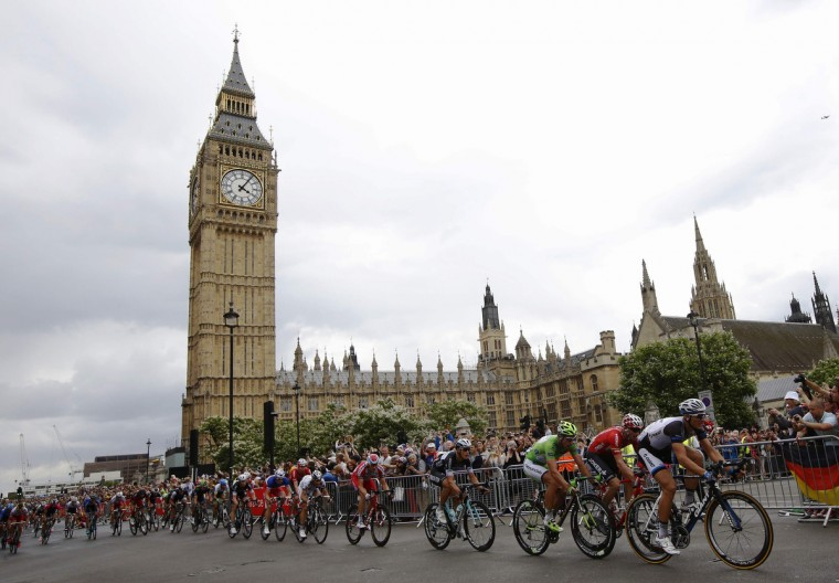 The pack of riders cycles on its way past the Big Ben clock tower and Houses of Parliament during the third 155 km stage of the Tour de France cycling race from Cambridge to London July 7, 2014. (Luke MacGregor/Reuters)
