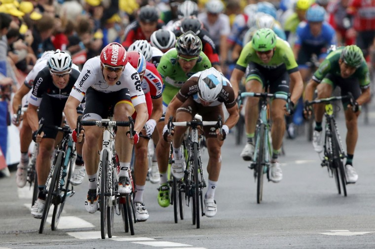 Lotto-Belisol team rider Andre Greipel of Germany sprints to win the 194 km sixth stage of the Tour de France cycling race from Arras to Reims July 10, 2014. (Jean-Paul Pelissier/Reuters)