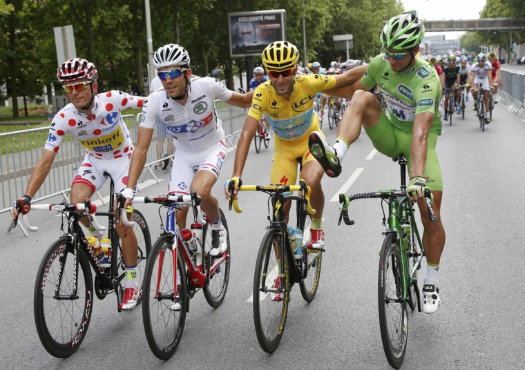 Best sprinter Cannondale team rider Peter Sagan of Slovakia (R) jokes with Astana team rider and leader's yellow jersey holder Vincenzo Nibali of Italy (2nd R) as they cycle with best climber's polka dot jersey holder Ral Majka of Poland (L) and best young jersey holder FDJ.fr team rider Thibaut Pinot of France during the 137.5 km final stage, from Evry to Paris Champs Elysees, July 27, 2014. (Jean-Paul Pelissier/Reuters)