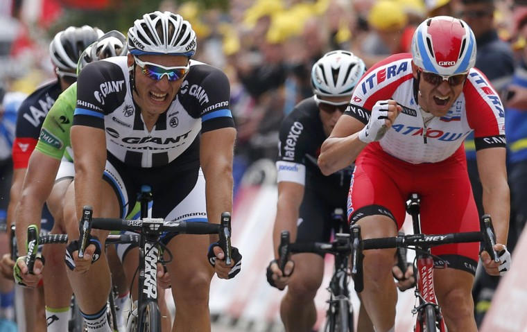 Giant-Shimano team rider Marcel Kittel (L) of Germany reacts as he crosses the finish line to win the 163.5 km fourth stage of the Tour de France cycling race from Le Touquet-Paris-Plage to Lille July 8, 2014. (REUTERS/Jean-Paul Pelissier)