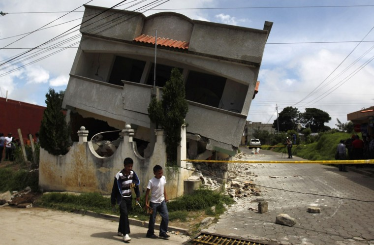 An earthquake-damaged house is pictured in the San Marcos region, in the northwest of Guatemala, July 7, 2014. A strong earthquake shook the Guatemalan border with Mexico on Monday, killing at least four people, damaging dozens of buildings and triggering landslides. The 6.9 magnitude quake struck near the frontier, and much of the damage was reported in the Guatemalan border region of San Marcos, where it downed power lines, opened cracks in buildings and triggered landslides which blocked roads. (REUTERS/Jorge Dan Lopez)