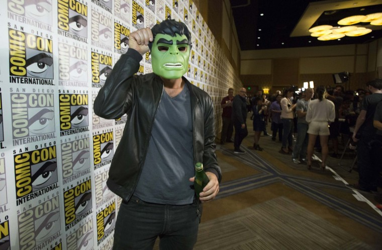"Cast member Corey Stoll holds a Hulk mask to his face as he poses at a press line for the movie ""Ant-Man"" during the 2014 Comic-Con International Convention in San Diego, California July 26, 2014. (Mario Anzuoni/Reuters)"