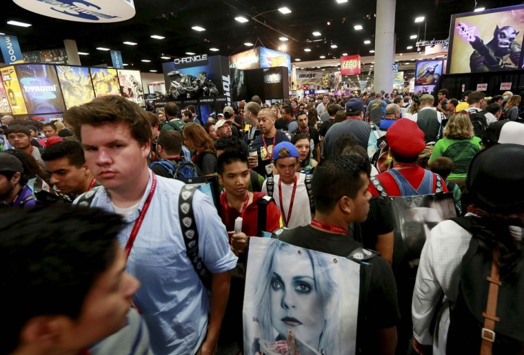 Attendees check out the booths during the 2014 Comic-Con International Convention in San Diego, California July 24, 2014. (Sandy Huffaker/Reuters)