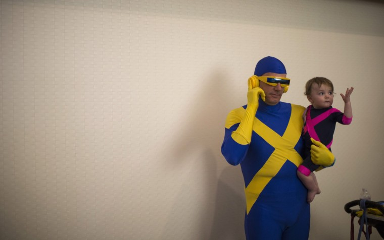 Attendee Mark Degenkolb and his daughter Doria pose dressed like the comic book characters while attending the 2014 Comic-Con International Convention in San Diego, California July 26, 2014. (Mario Anzuoni/Reuters)