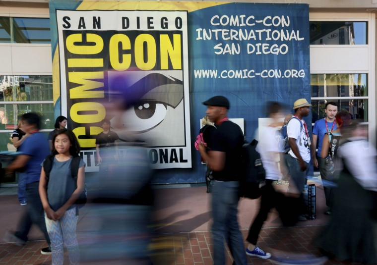 Attendees walk outside the Convention Center during the 2014 Comic-Con International Convention in San Diego, California, July 23, 2014. (Sandy Huffaker/Reuters)