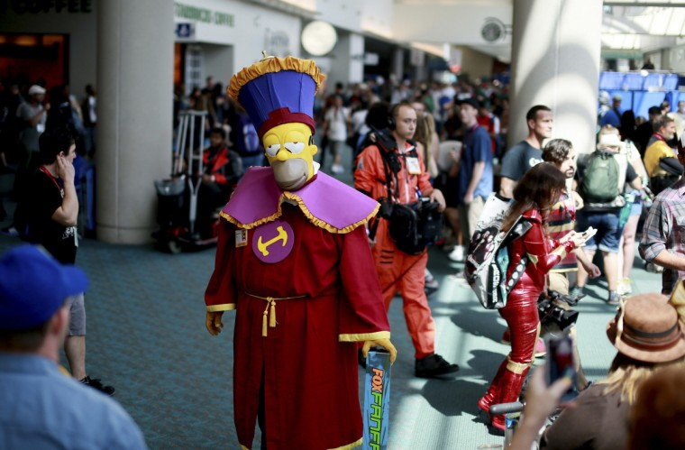 Kenneth McDaniel, who is dressed as Homer Simpson from The Simpsons, is seen during the 2014 Comic-Con International Convention in San Diego, California July 24, 2014. (Sandy Huffaker/Reuters)