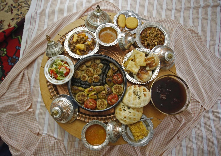 Dolma, a traditional dish of stuffed vegetables, and other food are laid out on a table at Mevlida Mrgic's home in the central Bosnian town of Zenica, July 13, 2014. During Ramadan, the ninth and holiest month in the Islamic calendar, Muslims refrain from eating and drinking during daylight hours. Reuters photographers took a series of portraits of Muslims observing Ramadan in different countries around the world, and asked them what food they liked to eat when breaking their daily fast. Eid-al-Fitr, marking the end of Ramadan, will be celebrated at the beginning of next week. Picture taken July 13, 2014. (Dado Ruvic/Reuters)