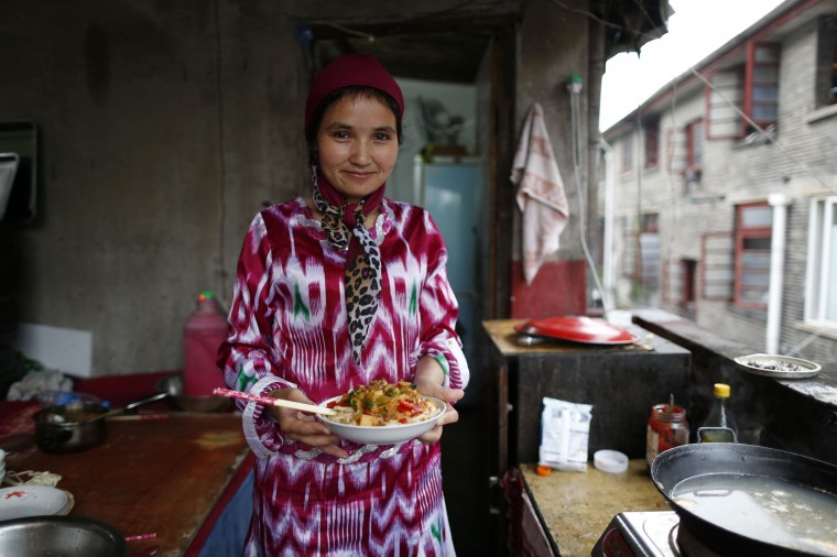 Patema Youssef, 22, an Uighur woman, holds a dish of Xinjiang noodles as she poses for a photograph at her home in Shanghai July 15, 2014. During Ramadan, the ninth and holiest month in the Islamic calendar, Muslims refrain from eating and drinking during daylight hours. Reuters photographers took a series of portraits of Muslims observing Ramadan in different countries around the world, and asked them what food they liked to eat when breaking their daily fast. Eid-al-Fitr, marking the end of Ramadan, will be celebrated at the beginning of next week. Picture taken July 15, 2014. (Aly Song/Reuters)