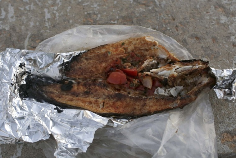 Grilled fish, which Hamed Mahmoud bought to break his fast, is seen in Alexandria, July 9, 2014. Mahmoud, from Cairo, said his favourite meal is grilled fish and seafood. While visiting Alexandria, he likes to eat with friends by the sea. During Ramadan, the ninth and holiest month in the Islamic calendar, Muslims refrain from eating and drinking during daylight hours. Reuters photographers took a series of portraits of Muslims observing Ramadan in different countries around the world, and asked them what food they liked to eat when breaking their daytime fast. Eid-al-Fitr, marking the end of Ramadan, will be celebrated at the beginning of next week. Picture taken July 9, 2014. (Asmaa Waguih/Reuters)