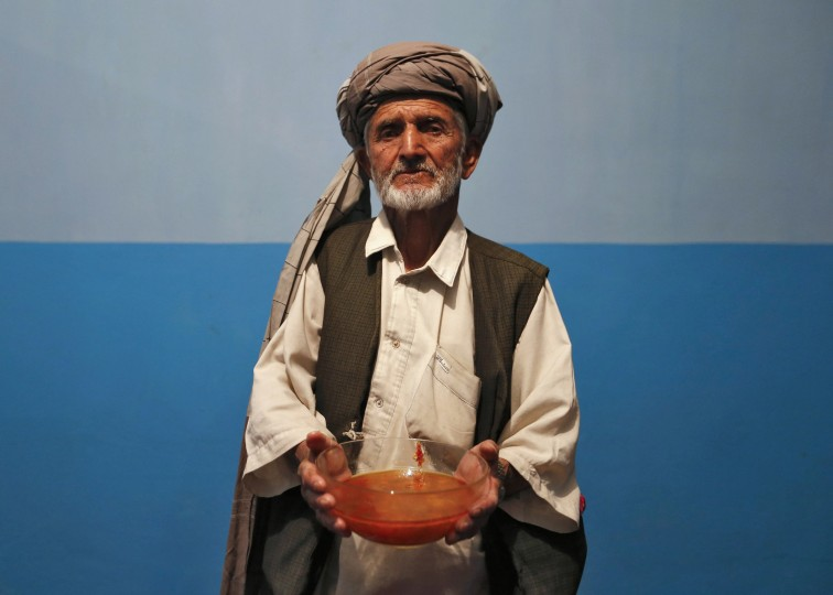 Mohammad Kabir, 64, holds a bowl of shorba, an Afghan soup made from beef or lamb, which is served with bread and potatoes as he poses for a photograph in Kabul, July 9, 2014. During Ramadan, the ninth and holiest month in the Islamic calendar, Muslims refrain from eating and drinking during daylight hours. Reuters photographers took a series of portraits of Muslims observing Ramadan in different countries around the world, and asked them what food they liked to eat when breaking their daily fast. Eid-al-Fitr, marking the end of Ramadan, will be celebrated at the beginning of next week. Picture taken July 9, 2014. (Mohammad Ismail/Reuters)