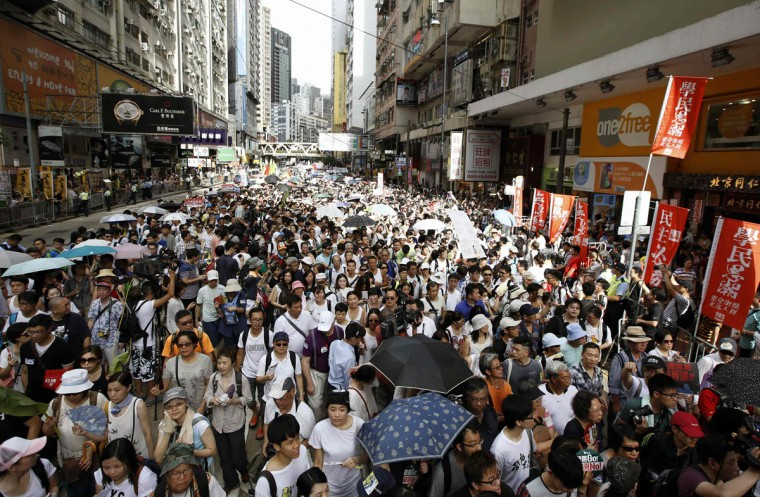 Tens of thousands of pro-democracy protesters stage a march to demand universal suffrage in Hong Kong July 1, 2014. Pro-democracy protesters gathered for a mass march in Hong Kong on Tuesday, with one burning a photograph of the city's leader and another calling for him to be sacked, in what could be the biggest challenge to Chinese Communist Party rule in more than a decade. (REUTERS/Tyrone Siu)