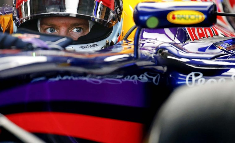 Red Bull Formula One driver Sebastian Vettel waits inside his car during the first free practice session ahead of the German F1 Grand Prix at the Hockenheim racing circuit, July 18. The German Grand Prix will take place on Sunday, July 20.   || PHOTO CREDIT: KAI PFAFFENBACH  - REUTERS
