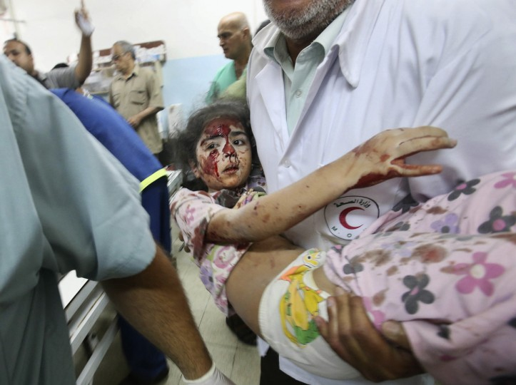 A Palestinian medic carries a girl, who medics said was wounded by Israeli shelling, at a hospital in Khan Younis in the southern Gaza Strip July 23, 2014. Israeli forces pounded the Gaza Strip on Wednesday, sending thousands of residents fleeing, and said it was meeting stiff resistance from Hamas Islamists, as U.S. Secretary of State John Kerry flew to Tel Aviv to push ceasefire talks. Israel launched its offensive on July 8 to halt missile salvoes by Hamas Islamists, who were struggling under the weight of an Israeli-Egyptian economic blockade and angered by a crackdown on their supporters in the nearby occupied West Bank. Some 643 Palestinians, many of them children and civilians, have died in the conflagration, including a seven-year-old hit by a shell in southern Gaza early Wednesday, a medic said. Some 29 Israeli soldiers have been killed, including a tank officer shot by a Palestinian sniper overnight. Two civilians have been slain by rocket fire. (Ibraheem Abu Mustafa/Reuters)