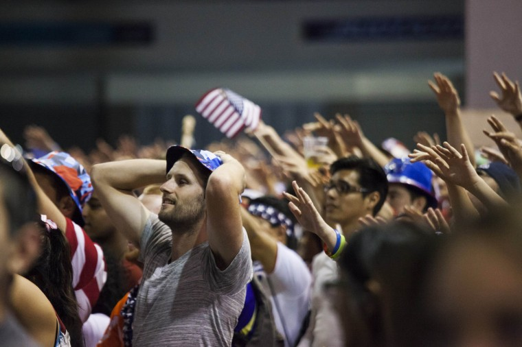 Fans react as they watch the United States take on Belgium in their World Cup round of 16 match, at a public viewing event in Seattle, Washington July 1, 2014. (David Ryder/Reuters)