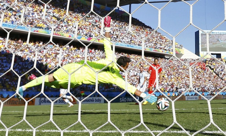 Switzerland's goalkeeper Diego Benaglio fails to save a goal by Argentina's Angel Di Maria during extra time in their 2014 World Cup round of 16 game at the Corinthians arena in Sao Paulo July 1, 2014. (Paul Hanna/Reuters)
