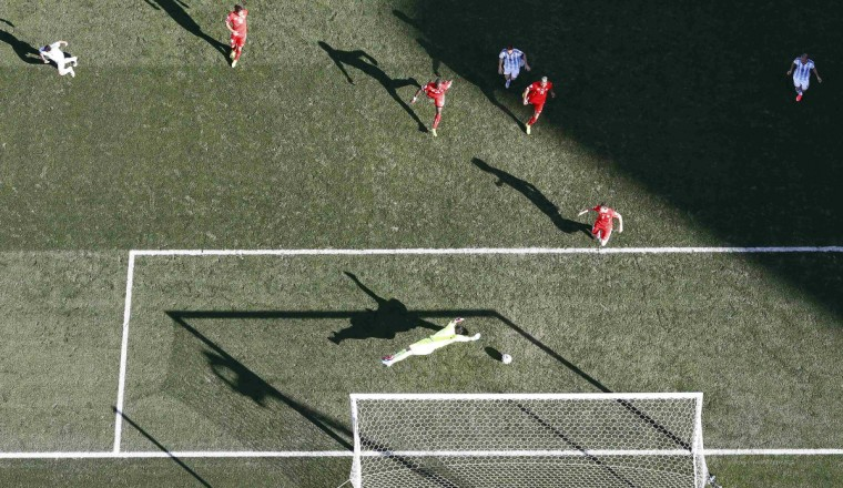 Switzerland's goalkeeper Diego Benaglio fails to save a goal by Argentina's Angel Di Maria (L) during extra time in their 2014 World Cup round of 16 game at the Corinthians arena in Sao Paulo July 1, 2014. (Pawel Kopczynski/Reuters)
