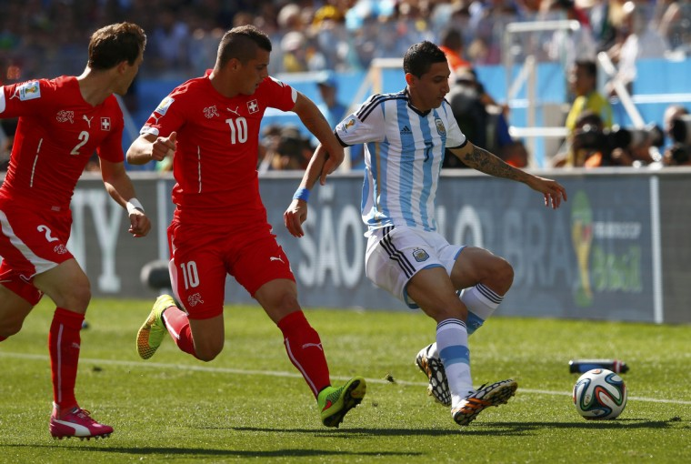 Argentina's Angel Di Maria fights for the ball with Switzerland's Stephan Lichtsteiner (2) and Granit Xhaka during their 2014 World Cup round of 16 game at the Corinthians arena in Sao Paulo July 1, 2014. (Eddie Keogh/Reuters)
