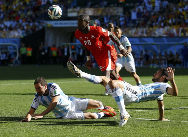 Argentina's Gonzalo Higuain (L) and Argentina's Ezequiel Garay (R) challenge Switzerland's Johan Djourou during their 2014 World Cup round of 16 game at the Corinthians arena in Sao Paulo July 1, 2014. (Ivan Alvarado/Reuters)