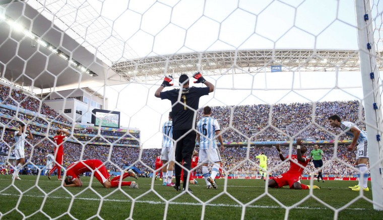 Switzerland players react after Blerim Dzemaili missed his header during extra time in the 2014 World Cup round of 16 game between Argentina and Switzerland at the Corinthians arena in Sao Paulo July 1, 2014. (Eddie Keogh/Reuters)