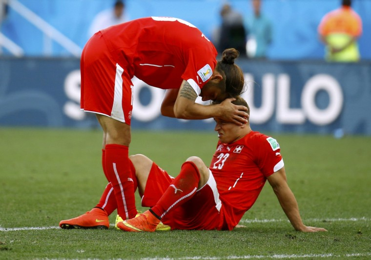 Switzerland's Ricardo Rodriguez (L) and Xherdan Shaqiri react after extra time in the 2014 World Cup round of 16 game between Argentina and Switzerland at the Corinthians arena in Sao Paulo July 1, 2014. (Kai Pfaffenbach/Reuters)