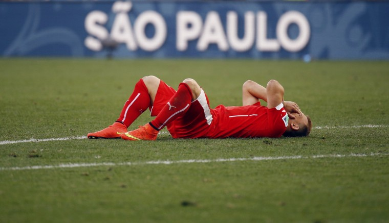Switzerland's Xherdan Shaqiri reacts after their loss to Argentina in their 2014 World Cup round of 16 game at the Corinthians arena in Sao Paulo July 1, 2014. (Kai Pfaffenbach/Reuters)