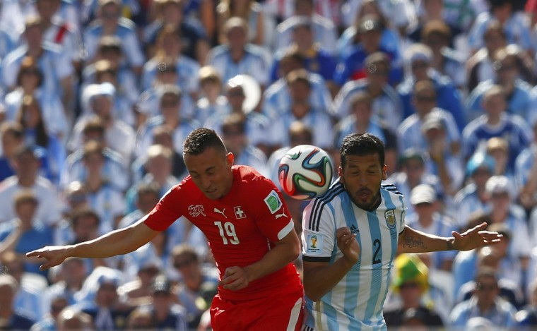 Switzerland's Josip Drmic fights for the ball with Argentina's Ezequiel Garay during their 2014 World Cup round of 16 game at the Corinthians arena in Sao Paulo July 1, 2014. (Eddie Keogh/Reuters)