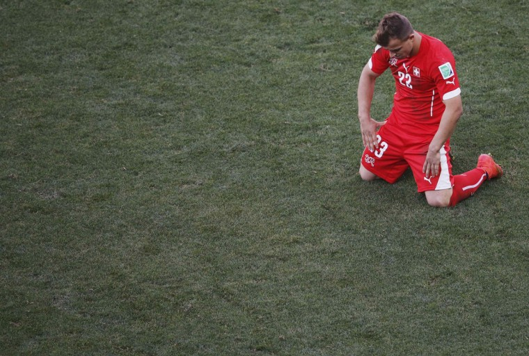 Switzerland's Xherdan Shaqiri reacts afte teammate Blerim Dzemaili (not pictured) failed to score a goal against Argentina during extra time in their 2014 World Cup round of 16 game at the Corinthians arena in Sao Paulo July 1, 2014. (Paulo Whitaker/Retuters)
