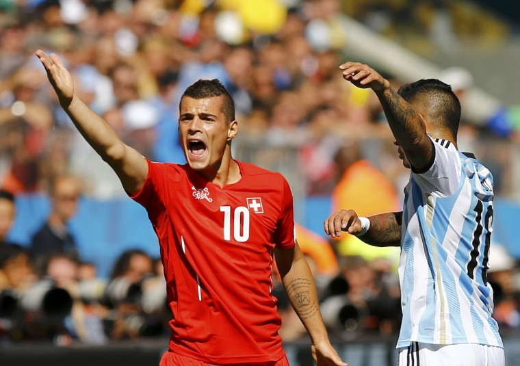 Switzerland's Granit Xhaka and Argentina's Marcos Rojo react during their 2014 World Cup round of 16 game at the Corinthians arena in Sao Paulo July 1, 2014. (Ivan Alvarado/Reuters)
