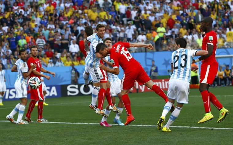 Switzerland's Blerim Dzemaili (15) heads the ball, which hit the goal post, during second half extra time in the 2014 World Cup round of 16 game between Argentina and Switzerland at the Corinthians arena in Sao Paulo July 1, 2014. (Eddie Keogh/Reuters)