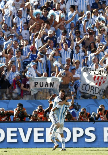 Argentina's Angel Di Maria celebrates with Lionel Messi (L) after scoring a goal during second half of the extra time in the 2014 World Cup round of 16 game between Argentina and Switzerland at the Corinthians arena in Sao Paulo July 1, 2014. (Eddie Keogh/Reuters)