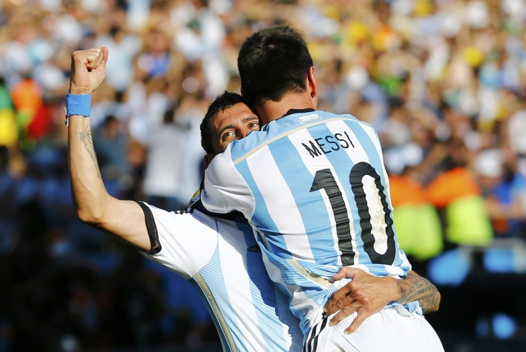 Argentina's Angel Di Maria celebrates after scoring a goal with teammate Lionel Messi during extra time in their 2014 World Cup round of 16 game against Switzerland at the Corinthians arena in Sao Paulo July 1, 2014. (Ivan Alvarado/Reuters)