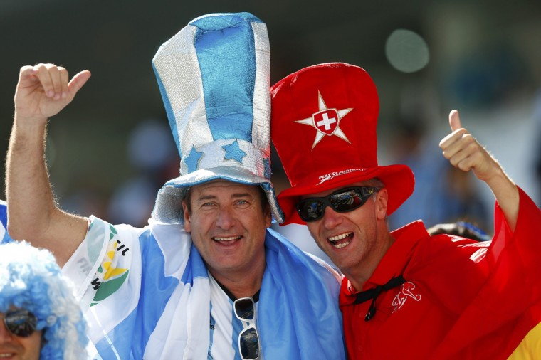 Fans pose before the 2014 World Cup round of 16 game between Argentina and Switzerland at the Corinthians arena in Sao Paulo July 1, 2014. (Eddie Keogh/Reuters)