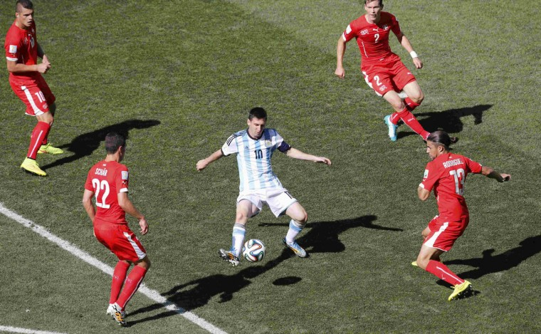 Argentina's Lionel Messi (C) is surrounded by Switzerland's Granit Xhaka (L), Fabian Schaer (2nd L), Stephan Lichtsteiner and Ricardo Rodriguez (R) during their 2014 World Cup round of 16 game at the Corinthians arena in Sao Paulo July 1, 2014. (Paulo Whitaker/Reuters)