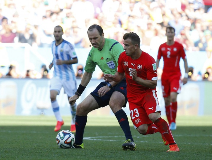 Referee Jonas Eriksson of Sweden accidentaly blocks Switzerland's Xherdan Shaqiri during the 2014 World Cup round of 16 game between Argentina and Switzerland at the Corinthians arena in Sao Paulo July 1, 2014. (Paul Hanna/Reuters)