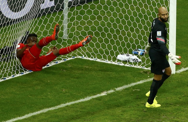 Belgium's Divock Origi throws himself into the goal net, behind goalkeeper Tim Howard of the U.S, after missing an opportunity to score a goal during their 2014 World Cup round of 16 game at the Fonte Nova arena in Salvador July 1, 2014. (Ruben Sprich/Reuters)