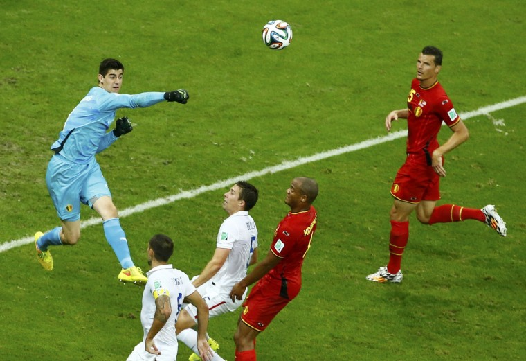 Belgium's goalkeeper Thibaut Courtois punches the ball out during their 2014 World Cup round of 16 game against the U.S. at the Fonte Nova arena in Salvador July 1, 2014. (Ruben Sprich/Reuters)