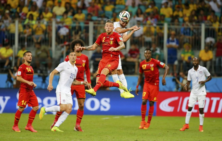 Belgium's Toby Alderweireld jumps for the ball with Alejandro Bedoya of the U.S. during their 2014 World Cup round of 16 game at the Fonte Nova arena in Salvador July 1, 2014. (Yves Herman/Reuters)