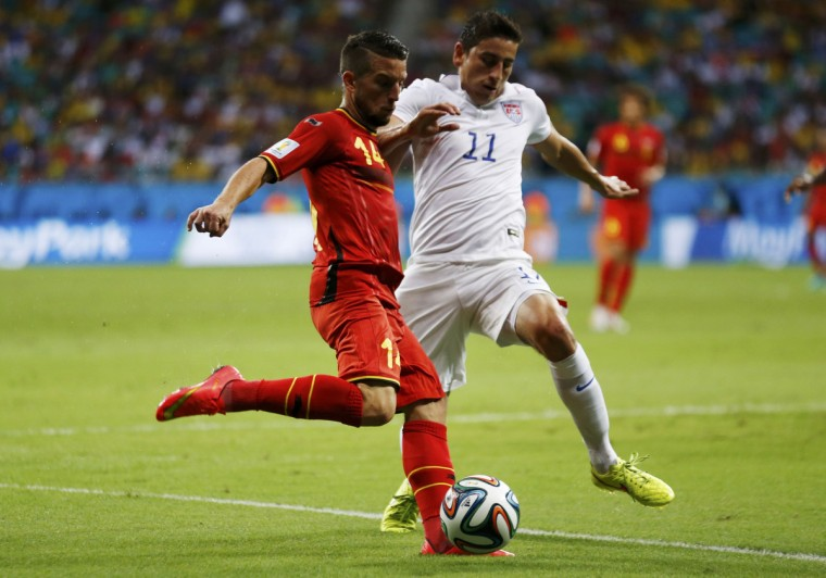 Belgium's Dries Mertens (L) fights for the ball with Alejandro Bedoya of the U.S. during their 2014 World Cup round of 16 game at the Fonte Nova arena in Salvador July 1, 2014. (Marcos Brindicci/Reuters)
