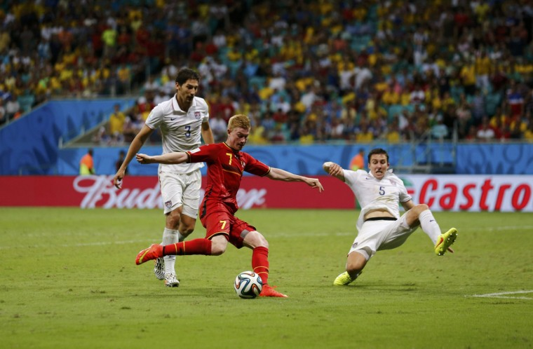 Belgium's Kevin De Bruyne (C) shoots to score against the U.S. in extra time during their 2014 World Cup round of 16 game at the Fonte Nova arena in Salvador July 1, 2014. (Marcos Brindicci/Reuters)