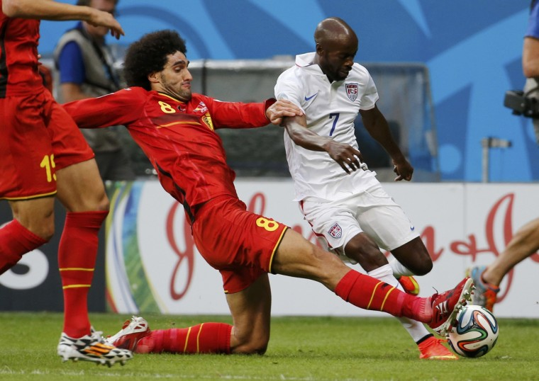 Belgium's Marouane Fellaini (L) fights for the ball with DaMarcus Beasley of the U.S. during their 2014 World Cup round of 16 game at the Fonte Nova arena in Salvador July 1, 2014. (Sergio Moraes/Reuters)