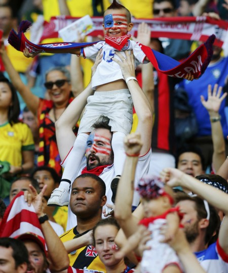 A young fan of the U.S. is held above the crowd amid the stands before their 2014 World Cup round of 16 game against Belgium at the Fonte Nova arena in Salvador July 1, 2014. (Yves Herman/Reuters)