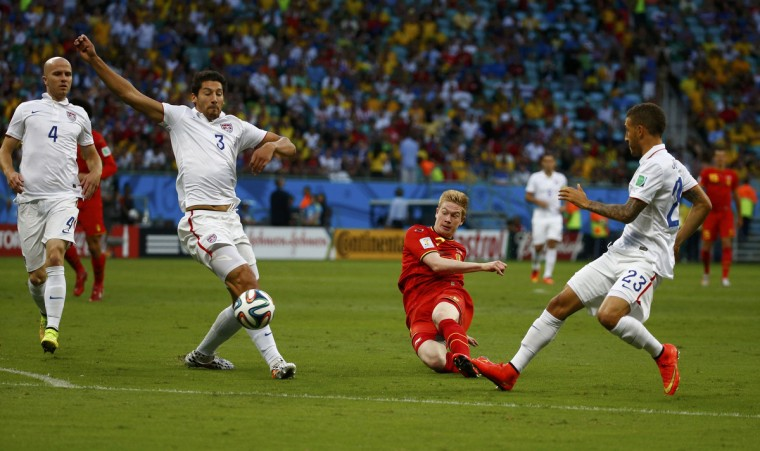 Belgium's Kevin De Bruyne (2nd R) attemps a shot past the U.S. players during their 2014 World Cup round of 16 game at the Fonte Nova arena in Salvador July 1, 2014. (Michael Dalder/Reuters)