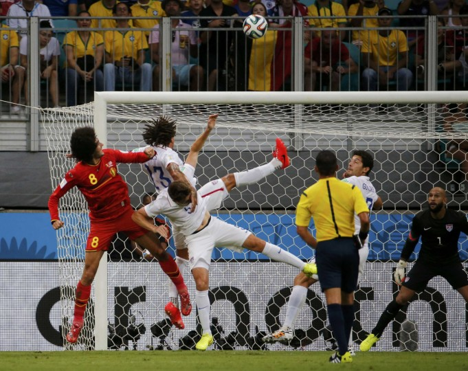 Belgium's Marouane Fellaini (L), Matt Besler and Jermaine Jones (13) of the U.S. fight for the ball during a corner kick in their 2014 World Cup round of 16 game at the Fonte Nova arena in Salvador July 1, 2014. (Sergio Moraes/Reuters)